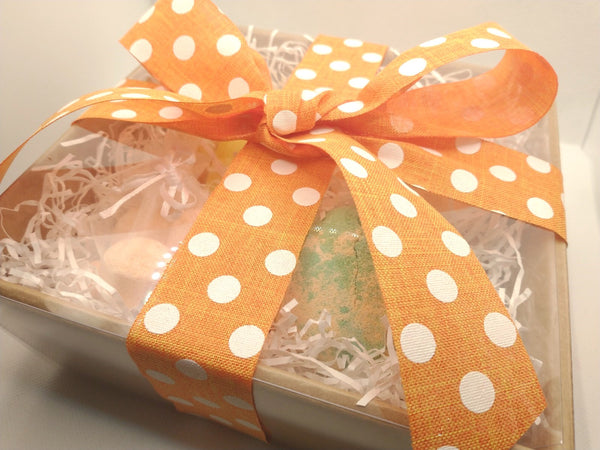 View of gift set at an angle showing the orange and white polka dot ribbon