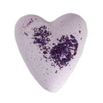 Lilac coloured heart shaped bath bomb on white background