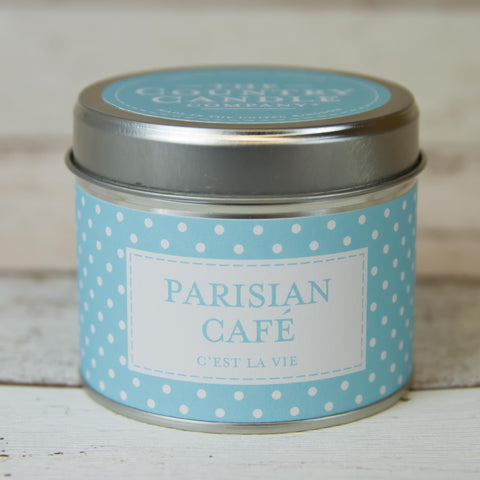 silver round tin with sky blue and white polka dot band labelled PARISIAN CAFE with sky blue sticker on lid with writing The Country Candle Candle Company