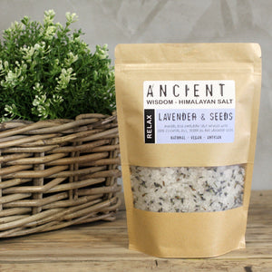 Bath Salts in kraft packing showing label Relax Lavender & Seeds displayed next to flower basket