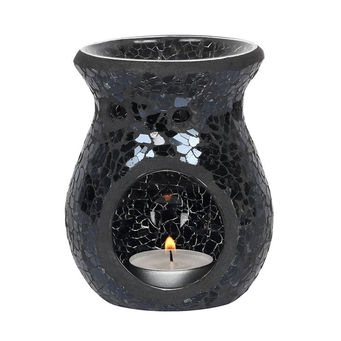 black oil and wax melt burner round with cut out showing a lit tealight candle, ceramic black in colour with a mosaic effect and a oil well on top