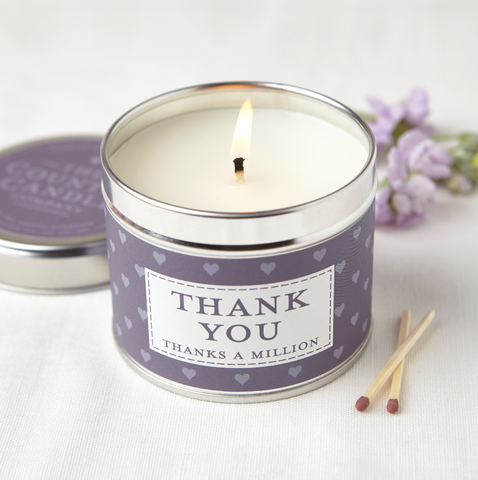 silver round tin with mauve heart band labelled THANK YOU with MAUVE sticker on lid with writing The Country Candle Candle Company