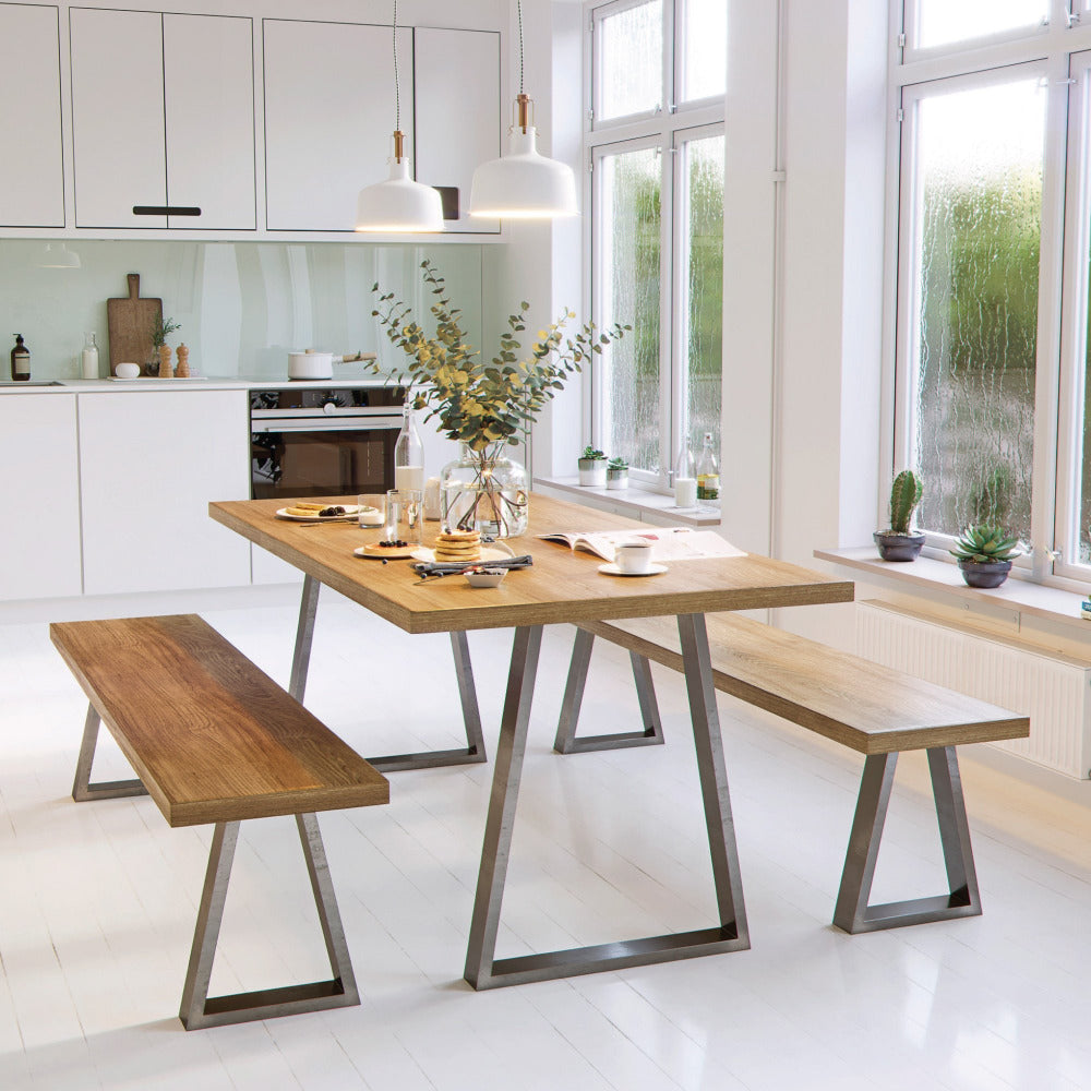 Industrial strength trapezium table legs in kitchen with table and benches