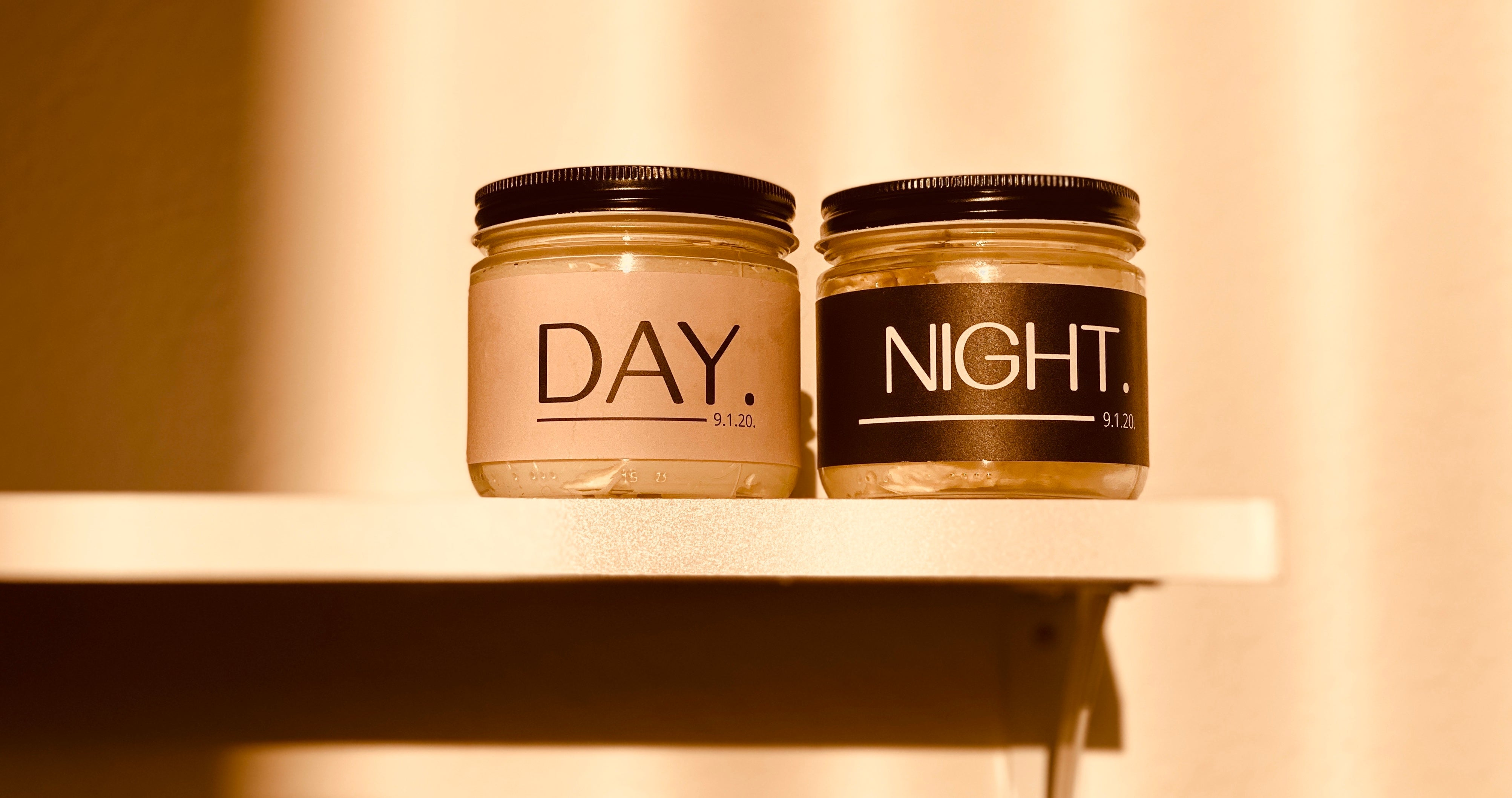 Day and Night Body Butters on a shelf in the sunlight