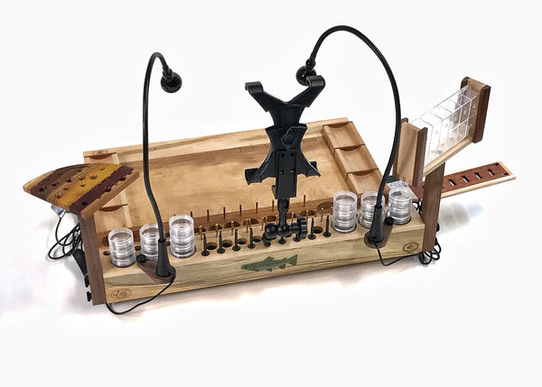 The large accessory in the back center is an A/V tool and tablet holder. It can either hold a tablet (I-pad, Surface, Etc.) for watching fly tying tutorials. By removing the tablet holder, the arm can also hold any video camera to film your fly tying.