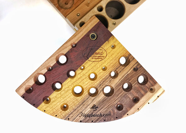 The tool swivel plate has holes for many different tools. The beveled holes make it easier to place the tool in the hole. The thirteen holes on the curved edge are for hanging newly tied flies. Every tool plate is glued up using different species of hardwoods making each one very colorful and unique.