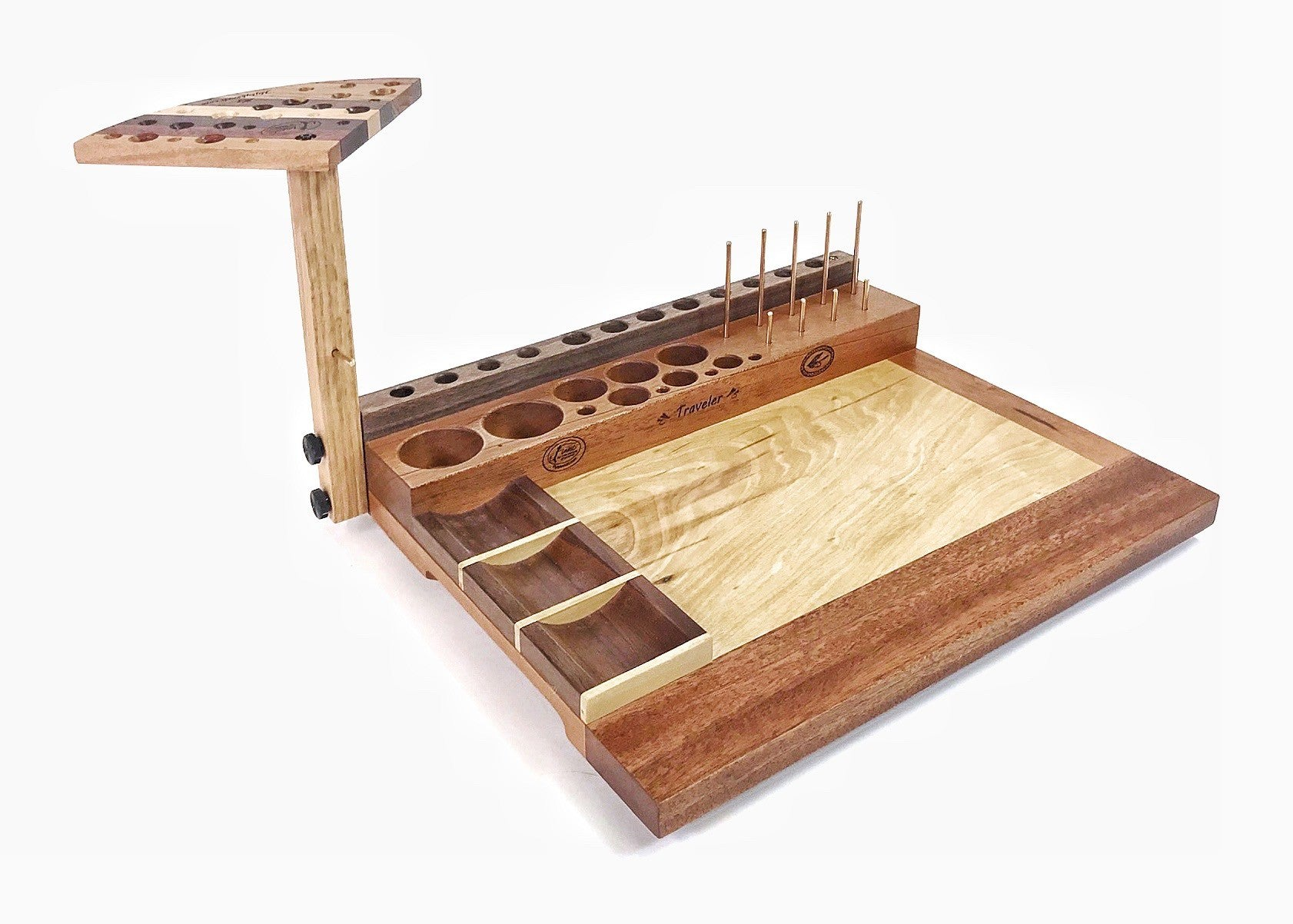 The Traveler fly tying bench is a great beginner bench. The fly tying bench in the photo is a left handed version. With the right side open, it makes pulling material into your hand easy.