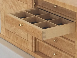 Another photo of the drawer corner dovetails and dividers.
