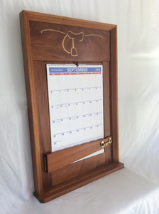 This calendar wall frame photo shows the completed frame with the gold paint and laser engraved logo on the top rail.