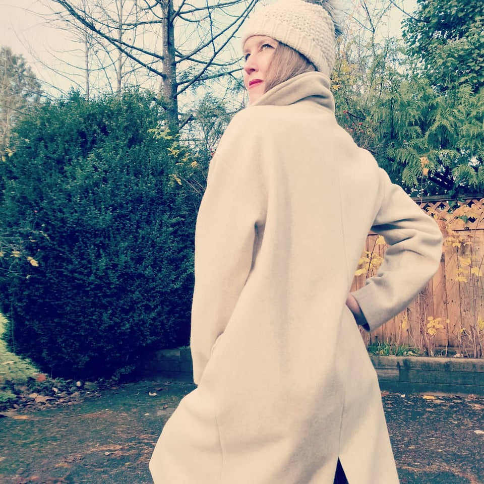 Christy modelling the LEXI COAT in oatmeal wool.