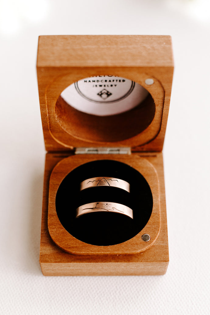 Katie and Christian's Mountain and Sea Custom Rings