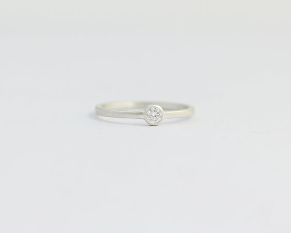 Solitaire Diamond Engagement Ring with Ethical Diamond in a Bezel Set