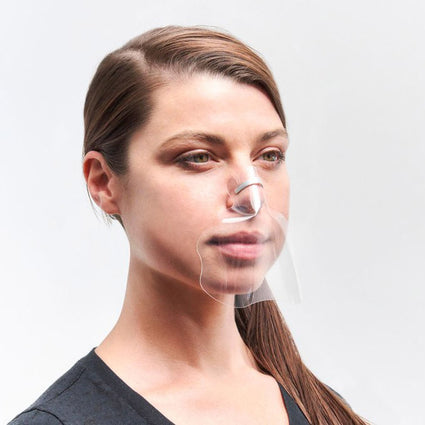 Female model wears the ViruShield Ghost, a clear mask that attaches to the nose bridge.