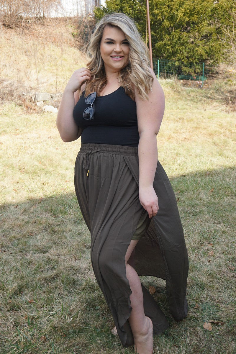 A maxi skirt that goes with everything is a necessity for your summer wardrobe. A maxi skirt that is the perfect shade of green, that lets you show some leg, and accentuates your waist? Well that sounds too good to be true. What can we say? We like to make the impossible, possible. 100% Polyester Hand wash Hand dry Imported Length Size:12/14 44