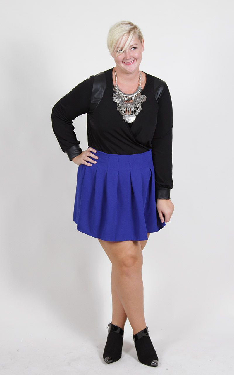 Wear this royal blue skirt edgy, preppy, or classic... any way you please! Whatever way you choose to rock it, you'll look stylish and breathtaking. After a test drive, the gals at Society+ recommend pairing with tights or leggings. 100% Polyester Hand wash Hang dry Made in China Front length Back length Size: 12/14 16.5