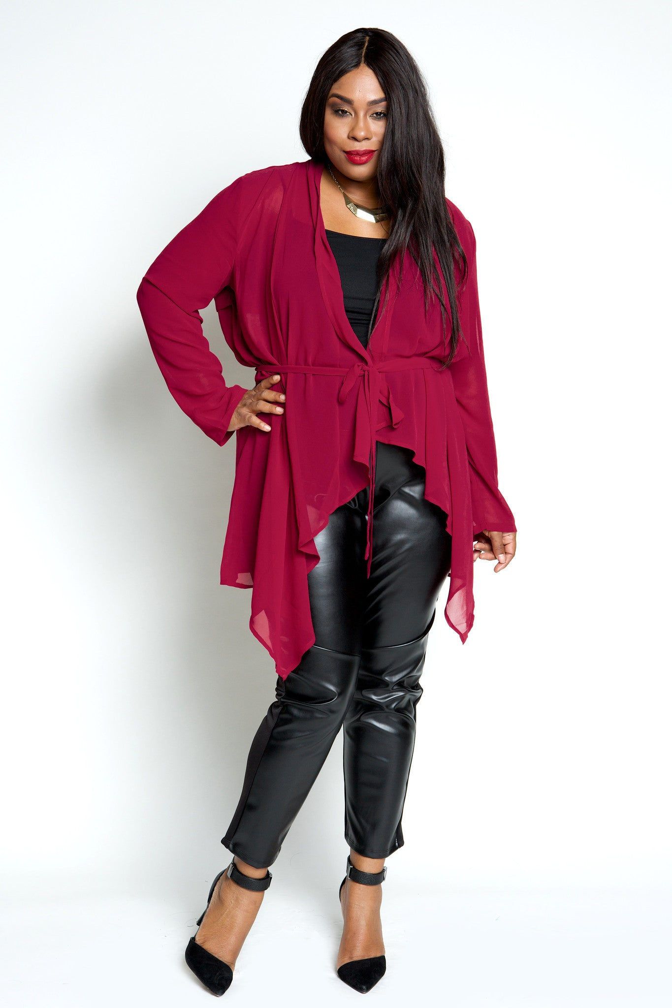 This perfectly flowy waterfall cardigan pairs beautifully over our full frontal faux leather leggings to give you a super chic look. Along with the tie detail and burgundy color, you are sure to feel like a boss babe! 100% Polyester With cold water Line dry Imported Front length Back length Arm hole Bicep Size:18/20 35