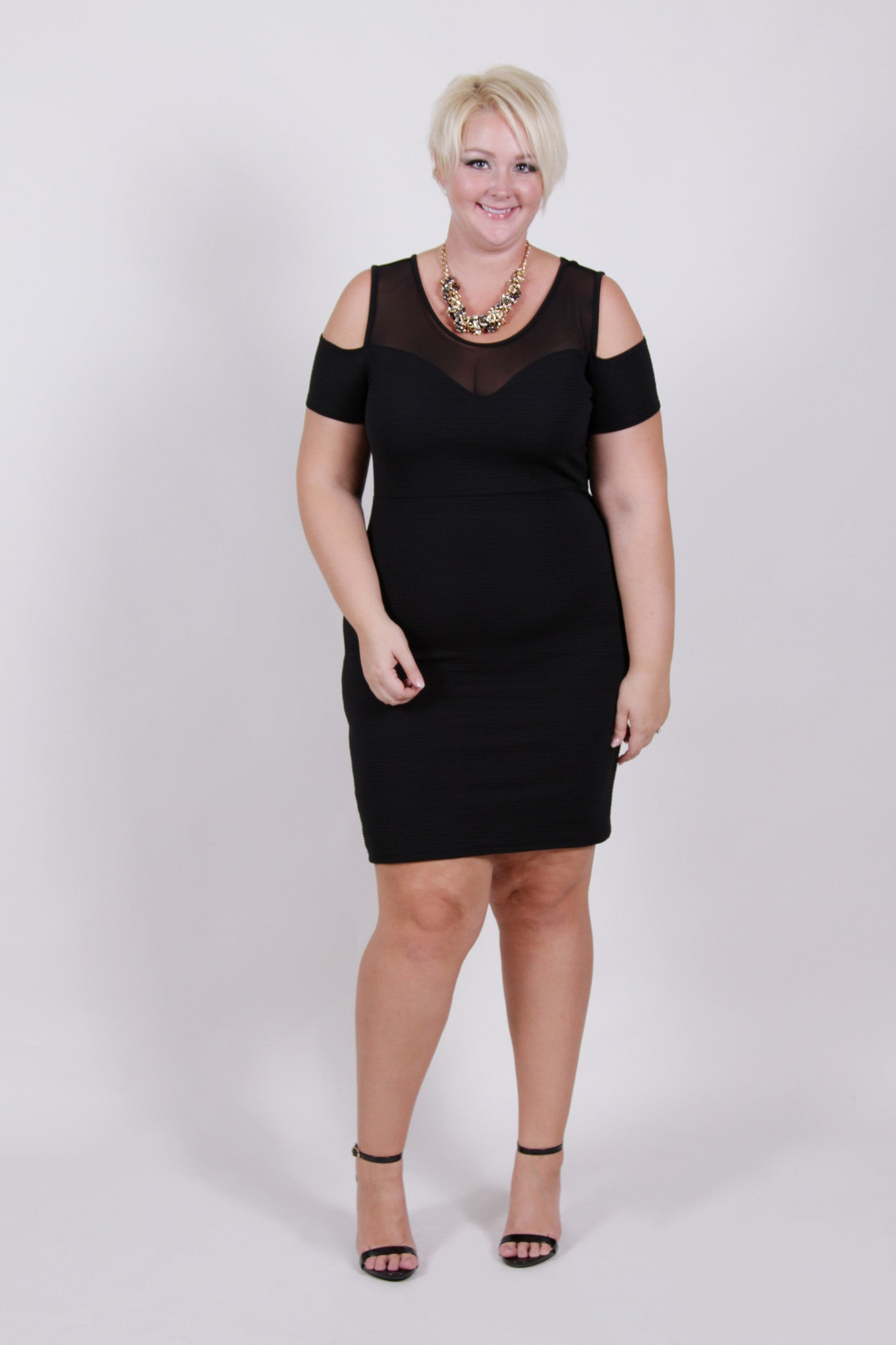 Caution: Curves ahead! Textured body con dress with open shoulders, and a sheer sweet heart cut bust. 95% Polyester, 5% Spandex Hand wash in cold water Hang or lay flat to dry Made in U.S.A Front length Back length Arm hole Size:14 33