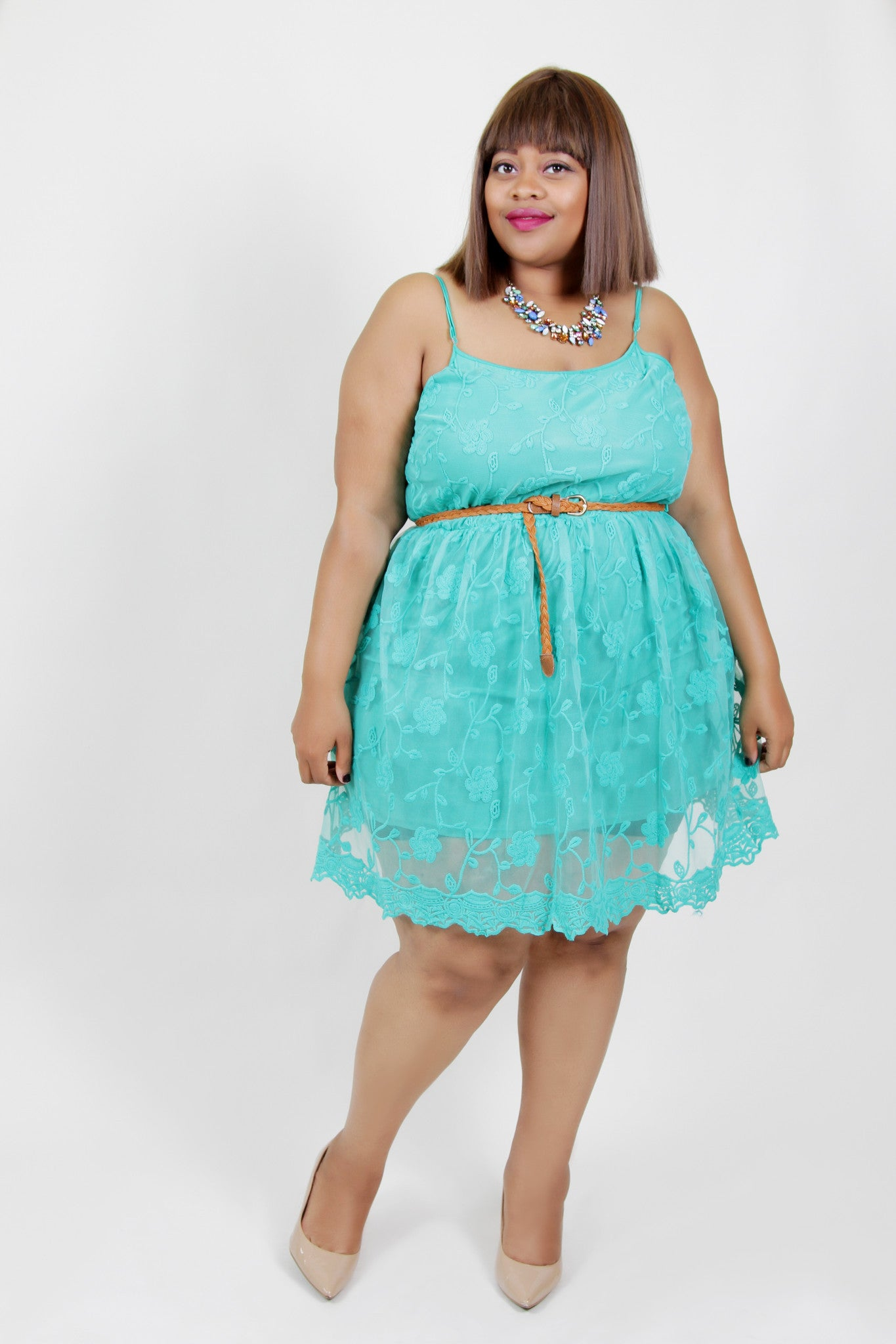 This lace flower dress with adjustable straps is sweet and feminine but dont let her fool you! She's powerful and strong too! Fully lined for coverage and cute leather b elt included. 100% Polyester Hand wash cold Hang to dry Imported Length Arm hole (adjustable straps) Size: 16/18 32.5
