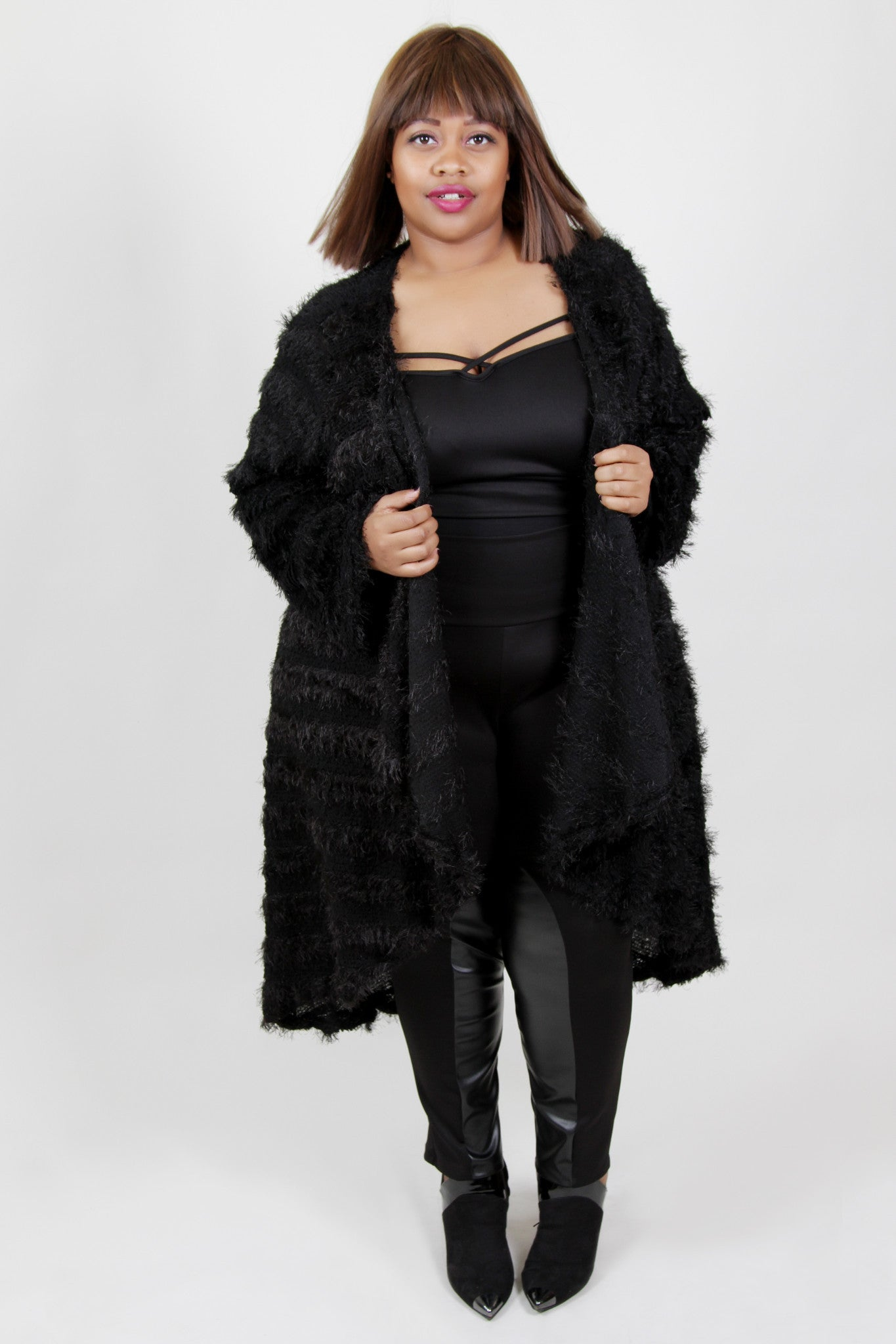 Talk about a show-stopper! This long cardigan will give you all the feels and have you feeling like you can take on the world...#girlboss style! 96% Polyester, 4% Spandex Hand wash with cold water Hang or line dry Made in U.S.A Length Arm hole Size:20/22 49