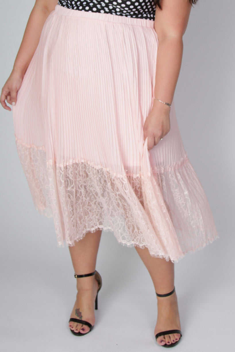 Whimsical is the word that comes to mind when thinking of this lace skirt. The mid-length under layer hugs your curves, while the lace overlay will have you twirling the day away. 100% Polyester Length Size:14/16 32