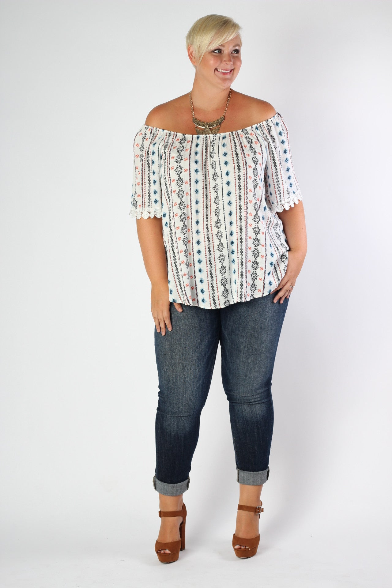 Show off those sunkissed shoulders in this fun off-the-shoulder top! You'll be sure to turn heads in this piece whether you're at the beach or out shopping with the gals. 100% Rayon Hand wash cold Hang dry Dry Cleaning recommended Made in USA Length Arm hole Size:14/16 26