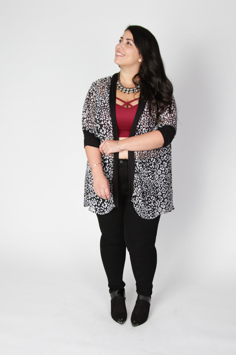 Few things can perk up an outfit like the perfect cardigan, and this is the perfect one for the edgy girl that you are. The chiffon texture flows over your perfectly put together outfit and the fun animal print brings the whole look together. Length Arm hole Size: 14/16 34