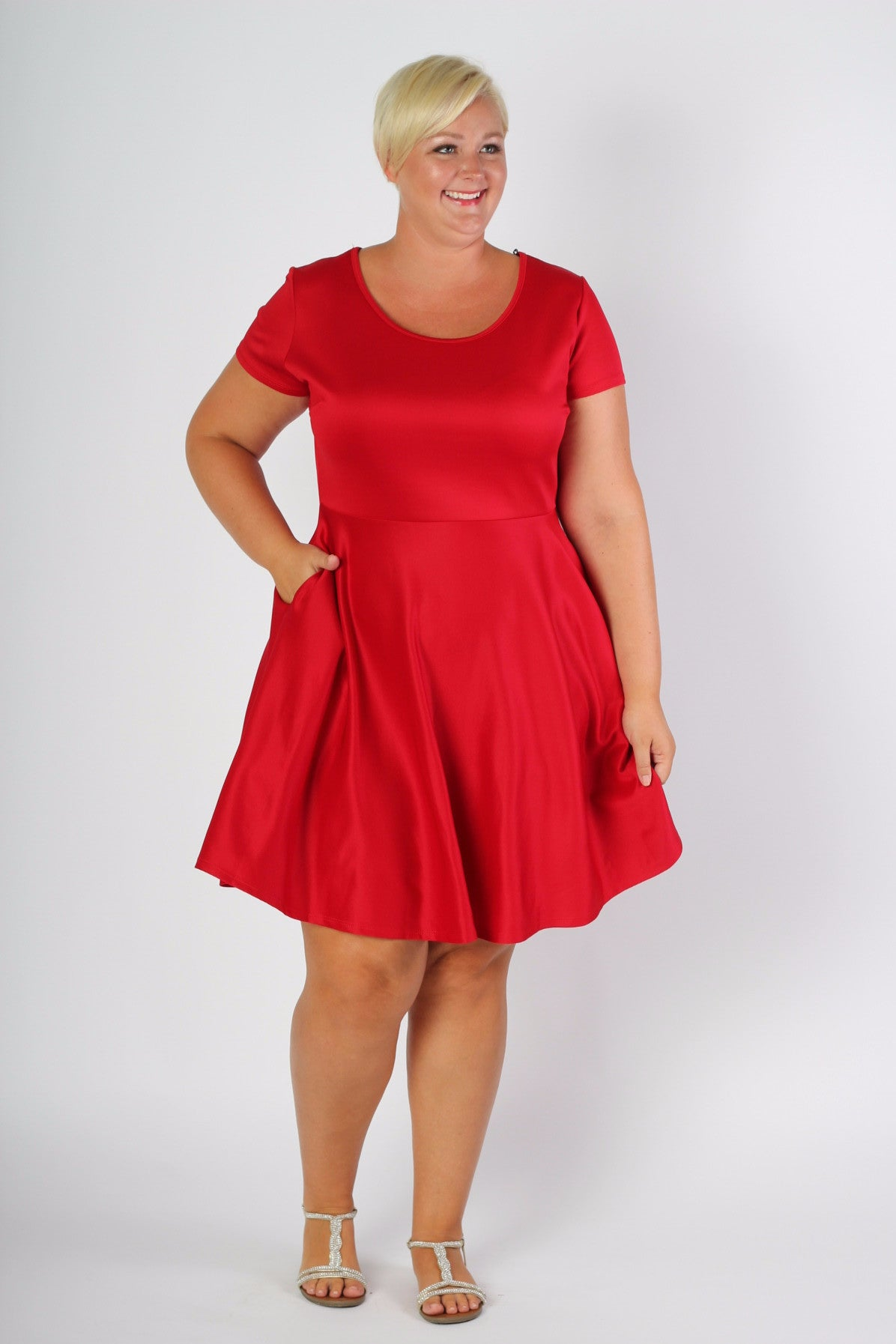 Our #1 Skater Dress now in more color and stripe options! This red dress features a new short sleeve and pockets. Our signature fit and flare silhouette perfect for any body type. Made with soft and forgiving scuba fabric, you will be comfortable and confident all day long in any situation! Plus, this gorgeous dress has pockets now! 96% Rayon, 4% Spandex Hand wash with cold water Do not bleach Hang or line dry Shop the Polyvore Size Note: Be sure to purchase the size that would fit your top (don't worry about the bottom size). The fabric is nice and stretchy and true to size. Front length Back length Arm hole Skirt length Size:14/16 39