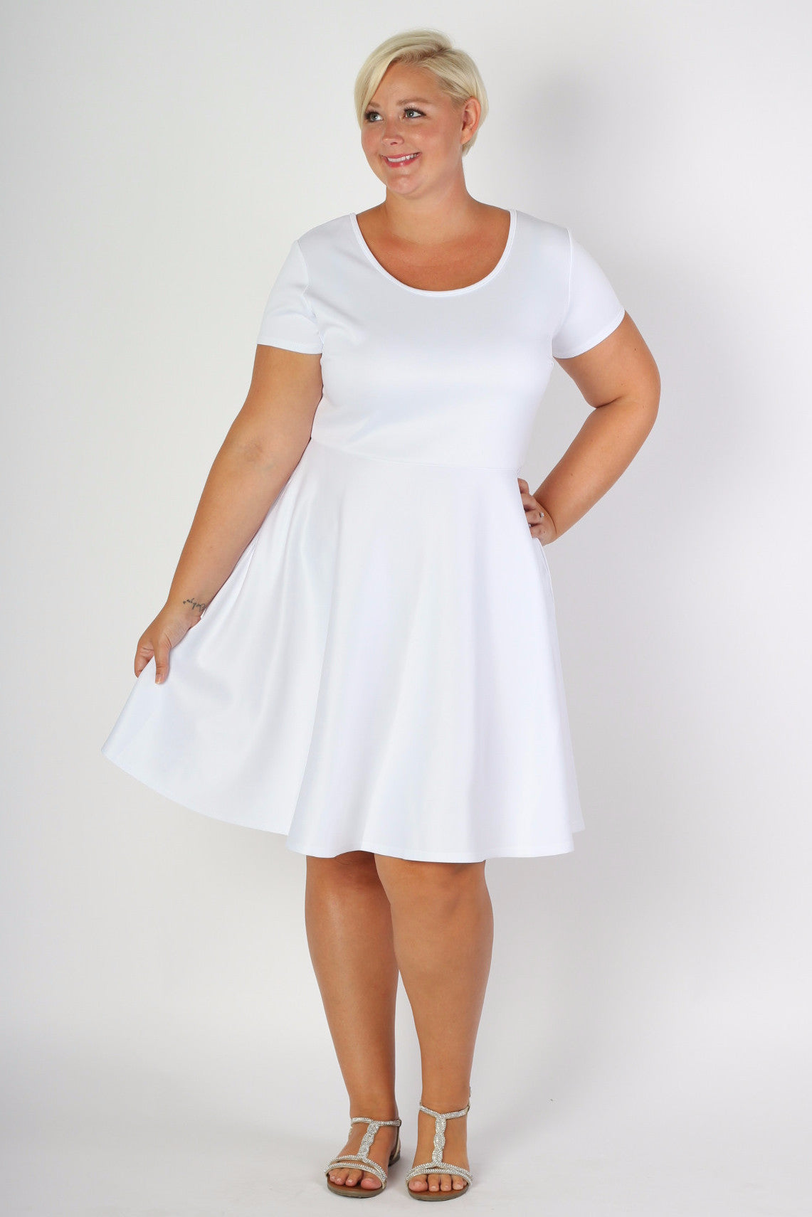 Our #1 Skater Dress now in more color and stripe options! This dress is a gorgeous bright white. Our signature fit and flare silhouette perfect for any body type. Made with soft and forgiving scuba fabric, you will be comfortable and confident all day long in any situation! Plus, this gorgeous dress has pockets now! 96% Rayon, 4% Spandex Hand wash with cold water Do not bleach Hang or line dry Size Note: Be sure to purchase the size that would fit your top (don't worry about the bottom size). The fabric is nice and stretchy and true to size. Front length Back length Arm hole Skirt length Size:14/16 39