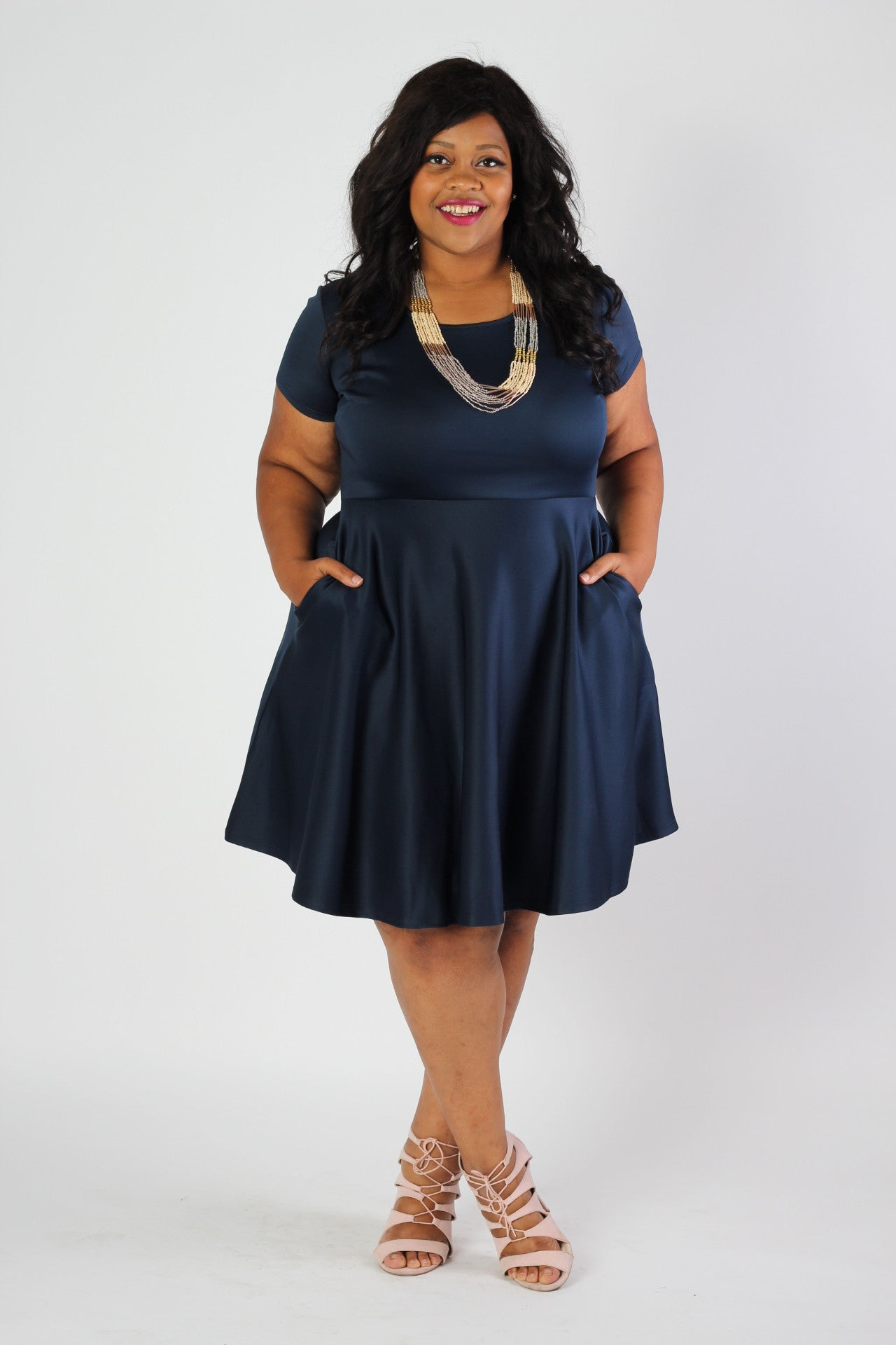 Our #1 Skater Dress now in more color and stripe options! This dress is a gorgeous navy blue color. Our signature fit and flare silhouette perfect for any body type. Made with soft and forgiving scuba fabric, you will be comfortable and confident all day long in any situation! Plus, this gorgeous dress has pockets now! 96% Rayon, 4% Spandex Hand wash with cold water Do not bleach Hang or line dry Size Note: Be sure to purchase the size that would fit your top (don't worry about the bottom size). The fabric is nice and stretchy and true to size. Front length Back length Arm hole Skirt length Size:14/16 39