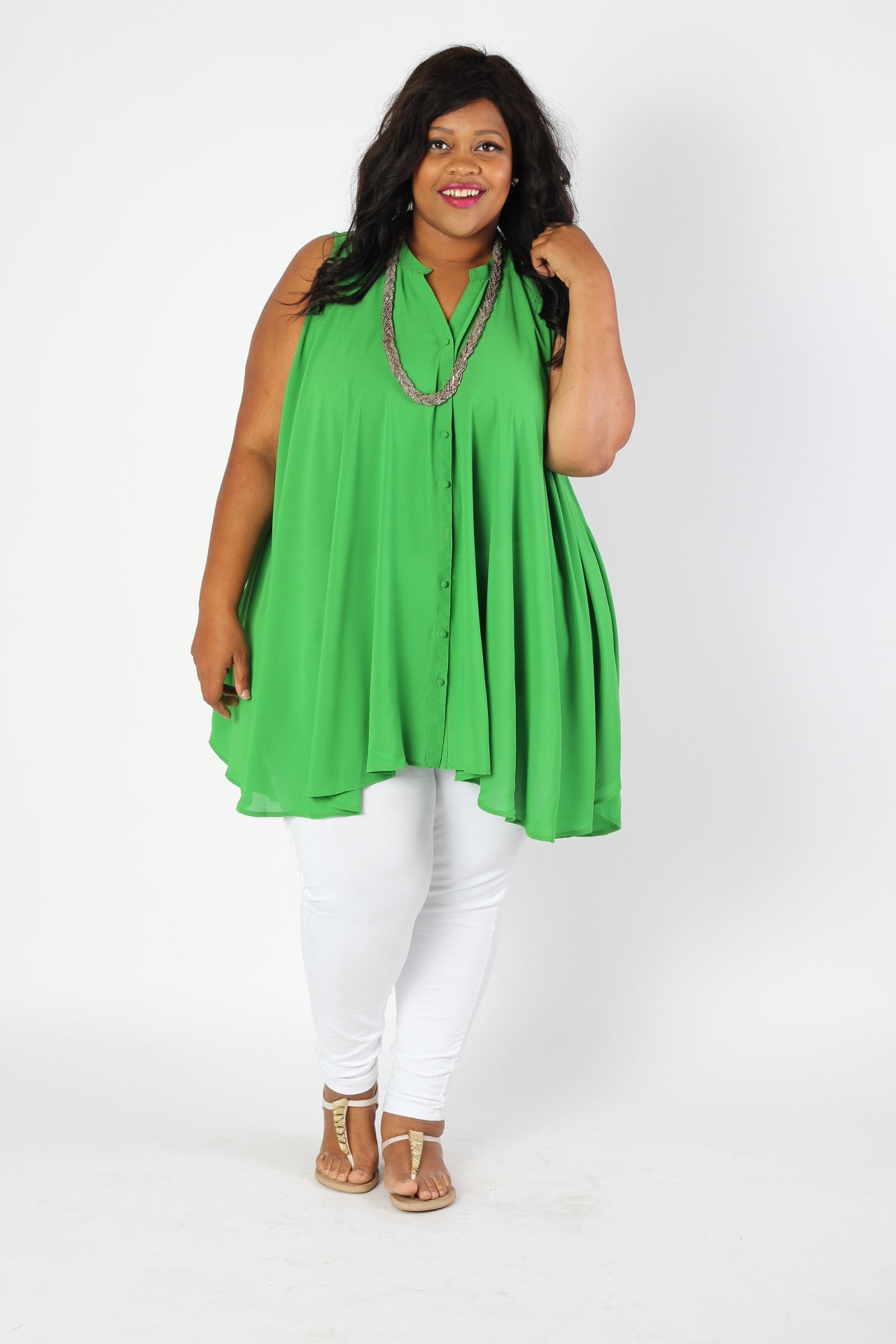 The best part of summertime is the easiness of fashion... which is why we're absolutely in love with this tunic! This button up tunic has a classic cut while the bright color keeps things fun and casual. You'll find that it's easy to pair with wedges or sandals, and everything in between. 55% Cotton, 45% Polyester Hand wash cold Hang to dry Imported Front length Back length Arm hole Size: 18/20 34
