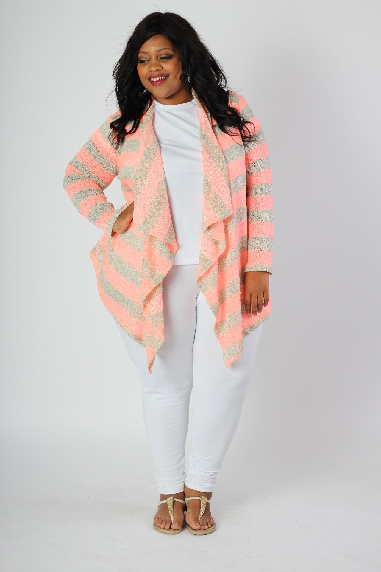 Pair this with: This is the perfect cardigan for spring and summer! Bright beautiful colors, but lightweight so you don't get over heated. 100% Polyester Hand wash with cold water Hang or line dry See it in pink . Front length Back length Arm hole Wrist opening Size:14/16 34