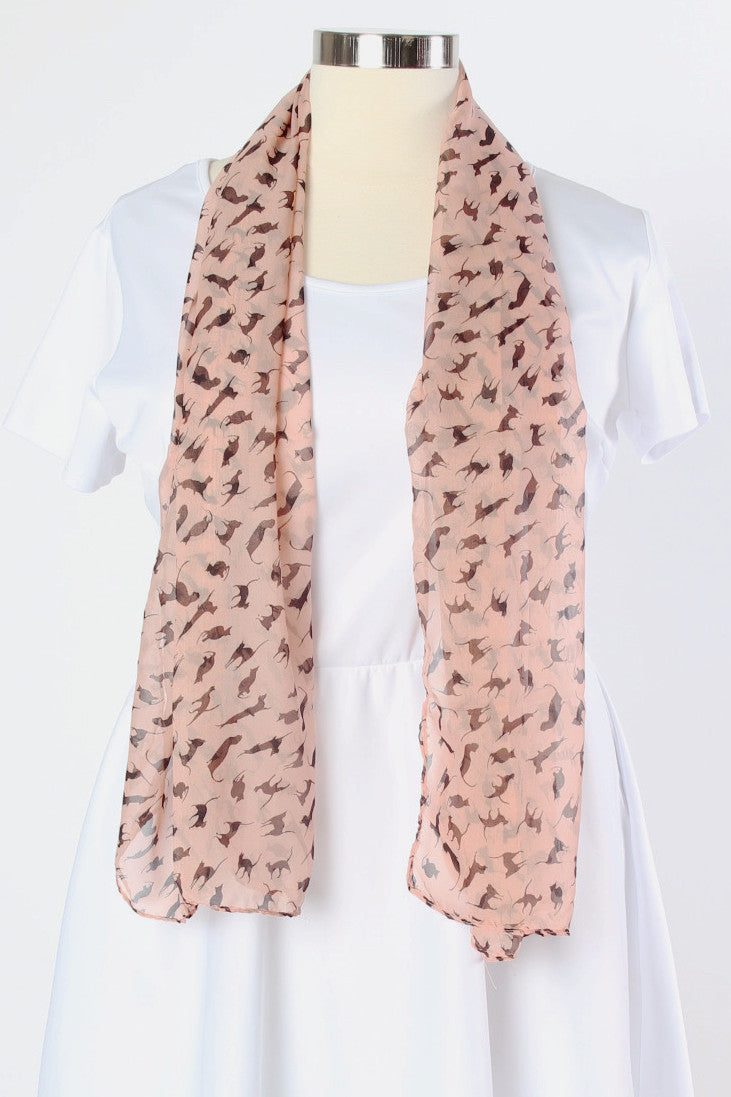 Cat lovers be prepared! This pink Cats Meow scarf is the most subtle way to tell the world your love of cats without having to saying a word. This light and flowy scarf is the perfect way to accessorize your outfits without overheating. Me-ow!