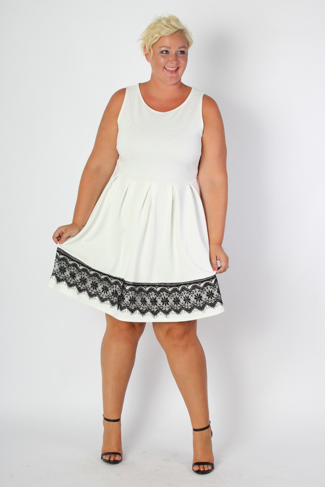 You like just a touch of refinement, a bit of lace that tells the world you are no ordinary babe. Our signature fit and flare silhouette is perfect for any body type. Made with a lightweight waffle fabric, you will be comfortable and confident in any situation! 92% Polyester 8% Spandex Hand Wash Cold Water Made in USA Size Bust Waist Hips Length Arm Hole Sweep 14/16 40