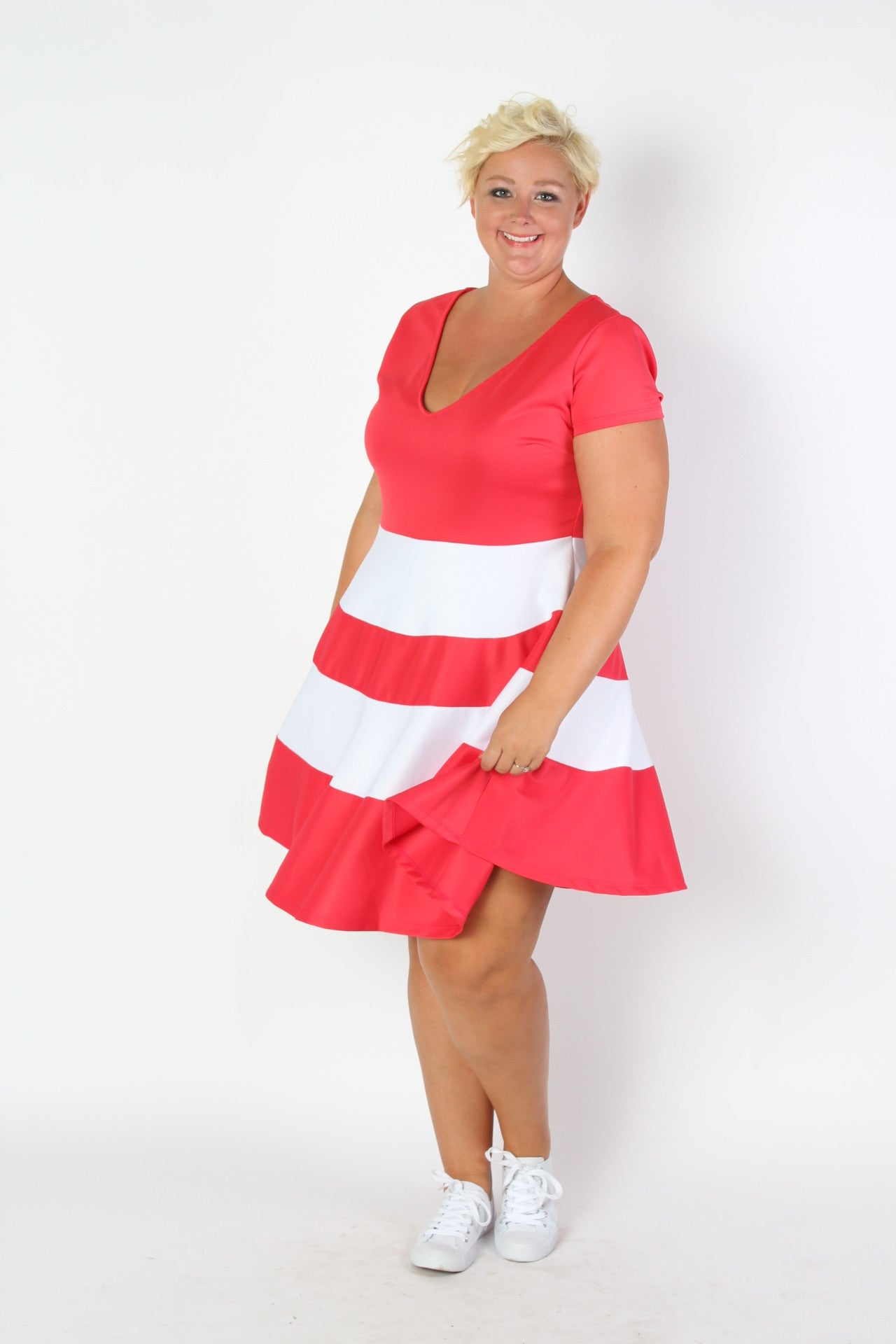 Our #1 Skater Dress is now in more color and stripe options! Our signature fit and flare silhouette perfect for any body type. Made with soft and forgiving, lightweight scuba fabric, you will be comfortable and confident all day long in any situation! 95% Polyester, 5% Spandex Hand wash with cold water Do not bleach Hang or line dry Size Bust Waist Hips Length Sleeve Length Arm Hole Sweep 14/16 40