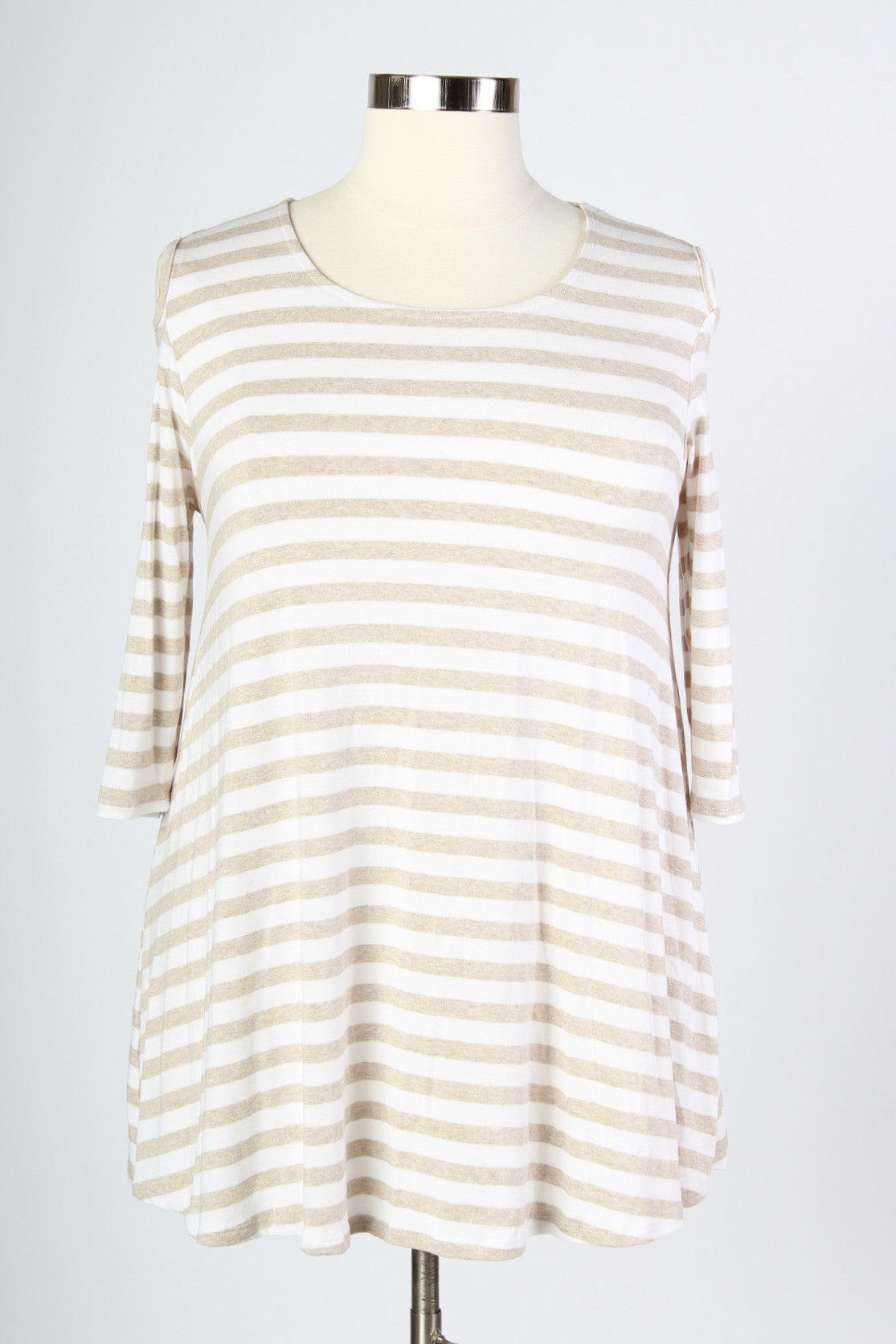 We all have that go-to striped top in our closet, but how about one with a little extra something? The open shoulder design gives this top a fun twist on the ordinary, and not to mention, a nice breeze too! 90% polyester, 10% spandex Hand wash in cold water Made in the USA Size Bust Waist Low Hip Length Sleeve Length Bicep Arm Hole 14/16 40