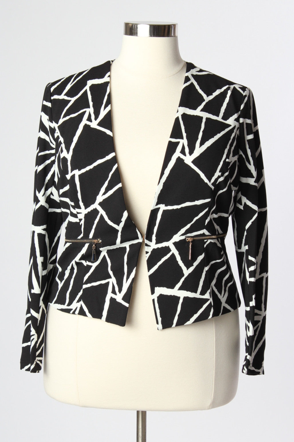 Mix up your work wear wardrobe and feel fearless in this fun and stylish abstract printed blazer. Pair with our White Leggings and pumps to make you feel like the powerful woman you are! This Blazer has a 1