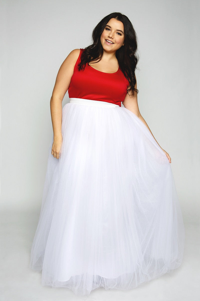 Our signature premium tulle skirt now in full length! Whether you dress her up for an all out glam look, or bring it down with sneaks and a tank for a casual day; our tutus can get you through any day with a smile! Our premium tutus have 5 layers of luxe tulle...more layers = more princess powers! Includes a full length satin inner layer for full coverage. 5 layers of premium tulle. Exposed White Elastic Waistband No Zipper Hand wash Air dry SIZE NOTE The size is equal to HIGH WAIST (3