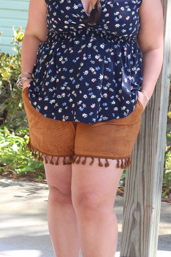 It seems like everyone is dying to get their hands on suede this season, which is why we just had to give you these perfect shorts. The tan suede is easy to pair with any top, and the tassels add some fun. Dress them up with some wedges or down with a strappy sandal, and watch as heads turn. Self: 100% Polyester Lining: 100% Cotton Hand wash separately with cold water Hang dry Imported Length Inseam Size: 12/14 14