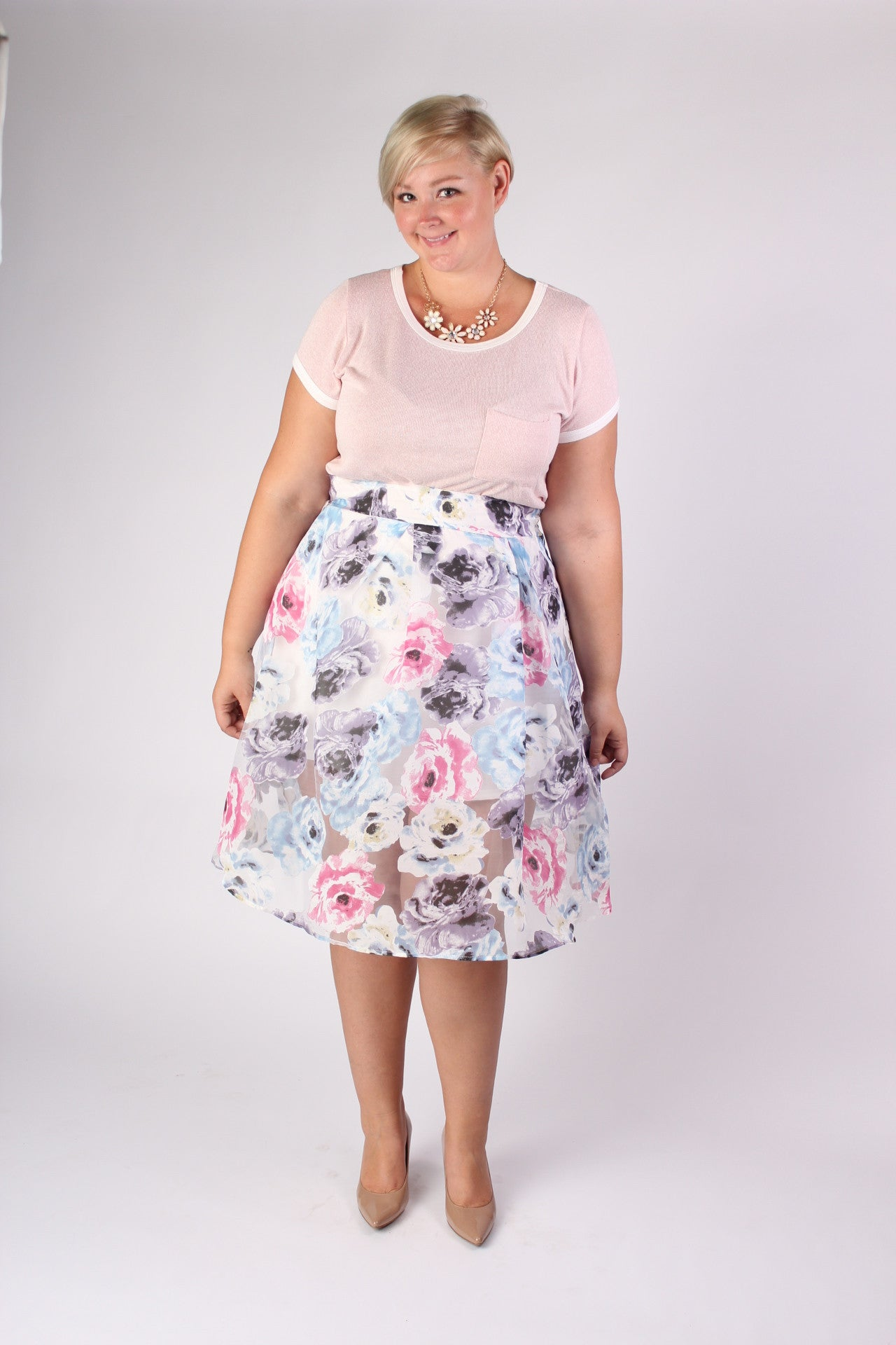 The perfect skirt has the perfect combination of cut, details, and the right amount of sass. This is the perfect skirt. The A-line cut compliments all your curves, the floral print screams summer, and the sheer top layer over the slip-like mini shows a little extra skin, all while keeping an air of mystery. What'd we say? Perfect. 100% Polyester Hand wash Made in U.S.A Length Size: 14/16 26.5