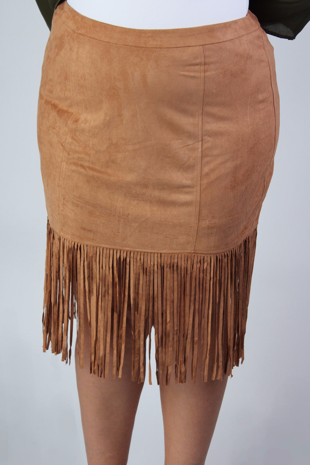It's safe to say suede is having a moment, but we aren't complaining, and this fringe skirt is definitely feeding our obsession. With the fit of a pencil skirt, but all the fun of Sunny and Cher, this skirt brings the appeal of a structured fit together with the world of hippy style, and we feel pretty groovy about it. Also available in c harcoal . 100% Polyester Hand wash cold Hang dry Imported Length (with fringe) Size: 12/14 29