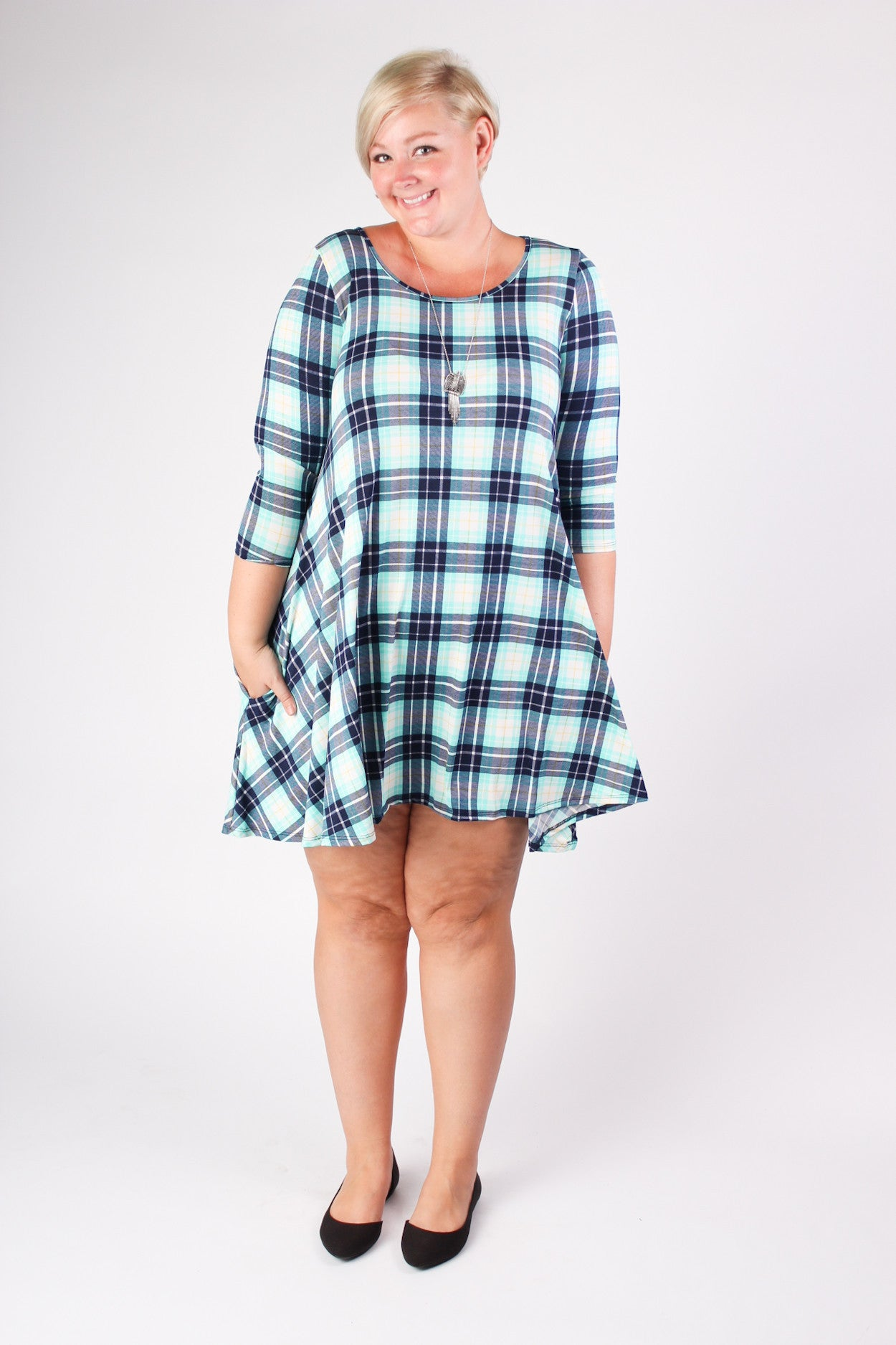 There's never a time when plaid isn't in style, but it seems especially perfect in the springtime, more specifically on a light dress. Wear it with sandals for a beachy feel, or make it a little more punk with leather boots and a jacket. 95% Rayon 5% Spandex Hand wash cold Made in USA Length Arm hole Sleeve length Size: 16/18 34