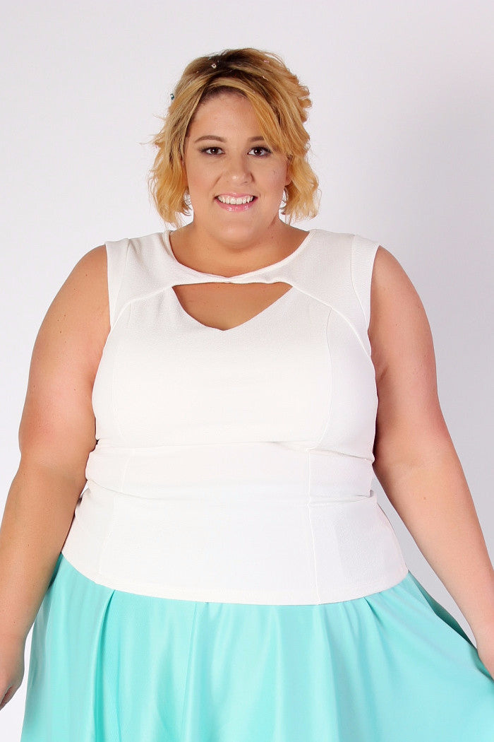 A comfy tank is great for spring and summer. But what's even better is that same tank with a cut out detailing for some added intrigue in a classic ivory color. Oh the wonderful places you'll go, and the wonderful outfits you'll make, in this perfectly precious top. Pair it with one of our new spring skirts: 95% Polyester 5% Spandex Hand wash cold Line dry Low iron Made in USA Front length Back length Arm hole Size: 12/14 26