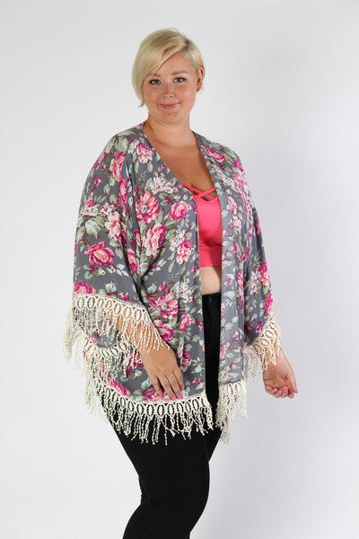 Spring time is all about bright patterns and fun details. That's why we love this floral cardigan. The bright floral pattern is toned down on the white back drop, and the crotchet tassels add some much needed hippy vibes. We can see this with a floppy hat or a little black dress. Whichever way you want to dress it, you'll be looking summer time fly. 60% Cotton, 40% Polyester Dry clean only Imported Front length Back length Arm hole Size:16 - 20 31