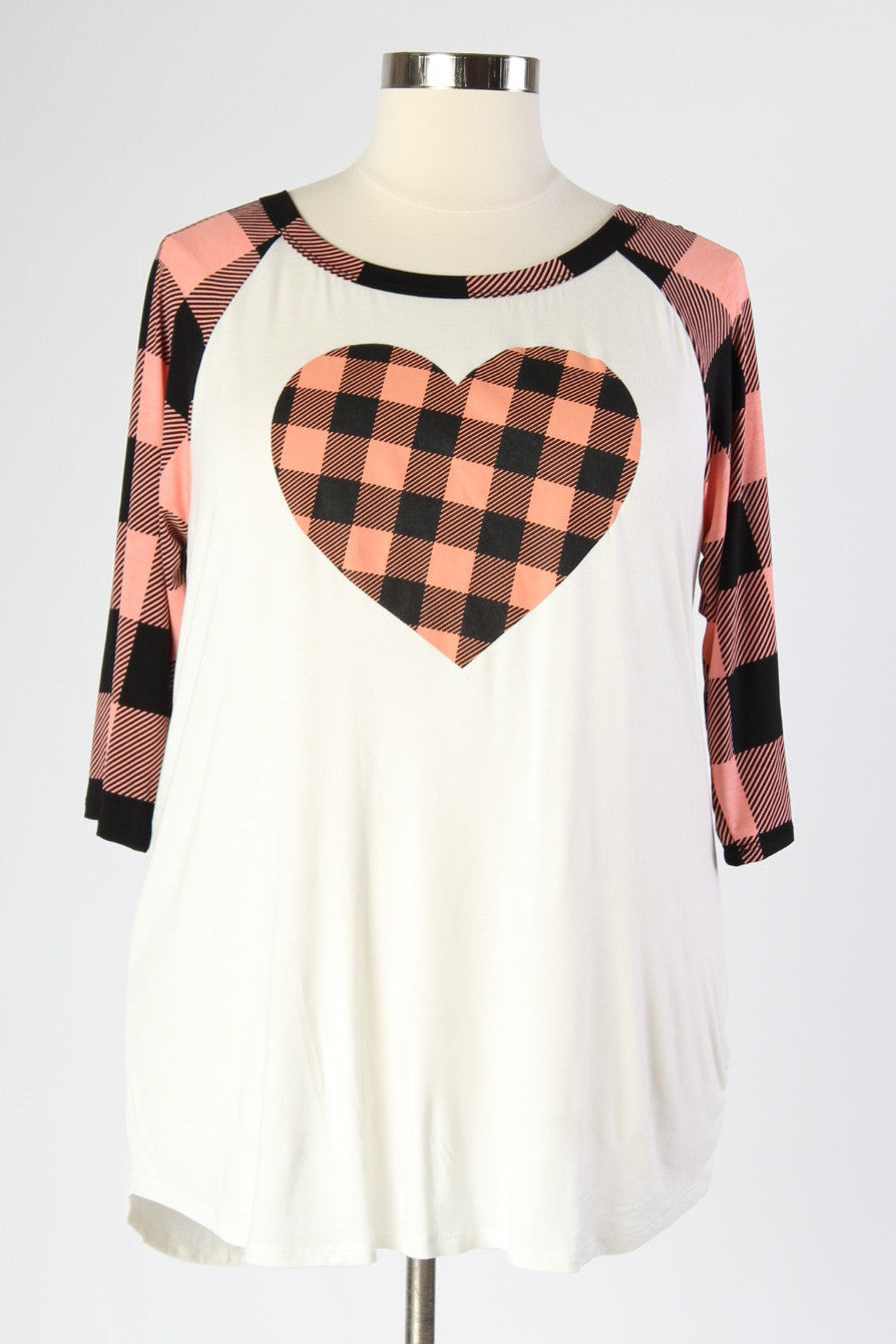 Everyone loves a good baseball tee. They're comfortable, easy to wear, and sporty cute. This shirt is all of that plus more with its fun details. The plaid sleeves and heart embelishment on the front make the whole look a little something special. 95% Rayon, 5% Spandex Dry clean only Made in USA Length Size:14/16 29