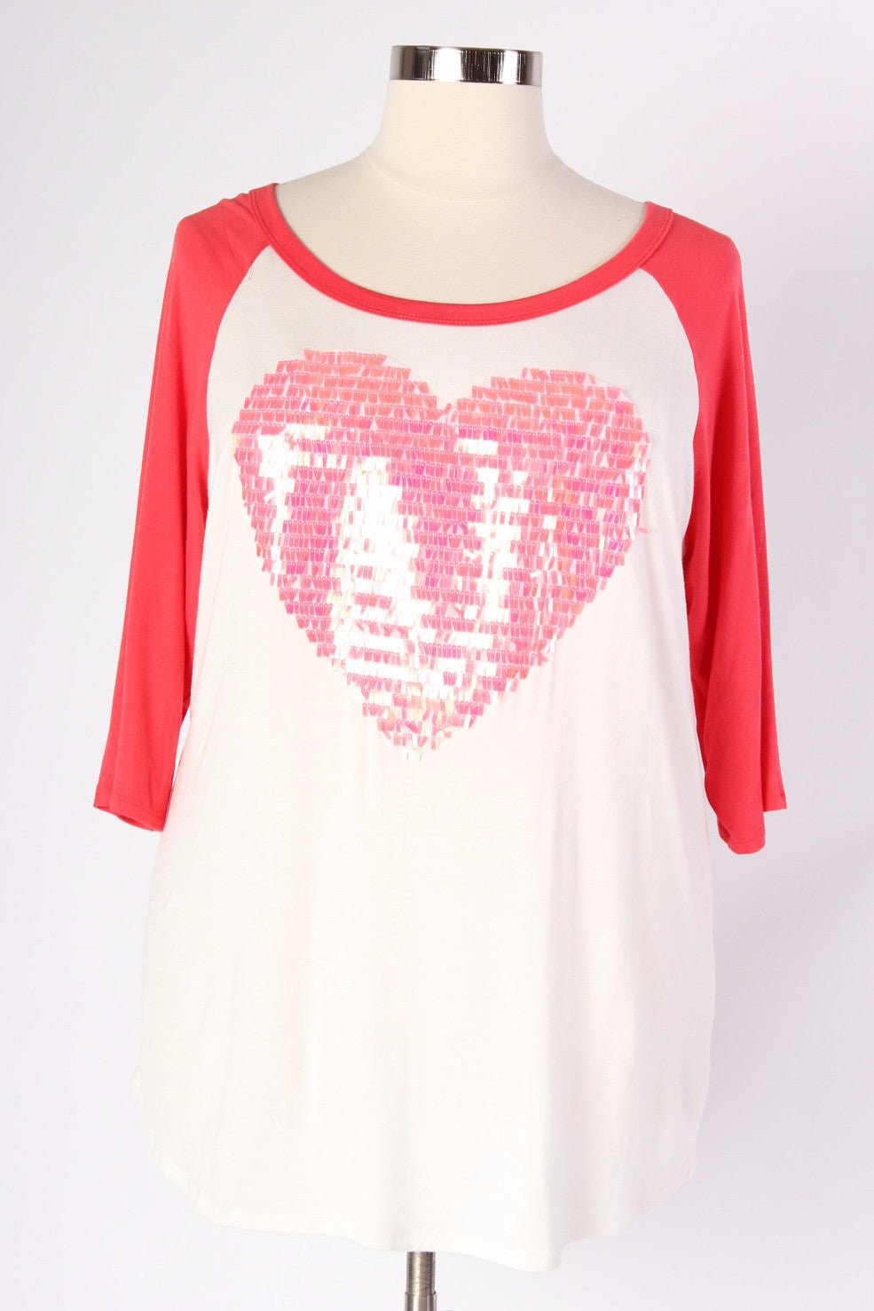 Why not show a little love to the world? And what better way to do that than with sequins? This comfy baseball style tee is easy to dress up or dress down and it makes it easy to show your loving side, all while looking precious. 96% Polyester, 4% Spandex Dry clean only Made in USA Front length Back length Arm hole Size:16/18 32