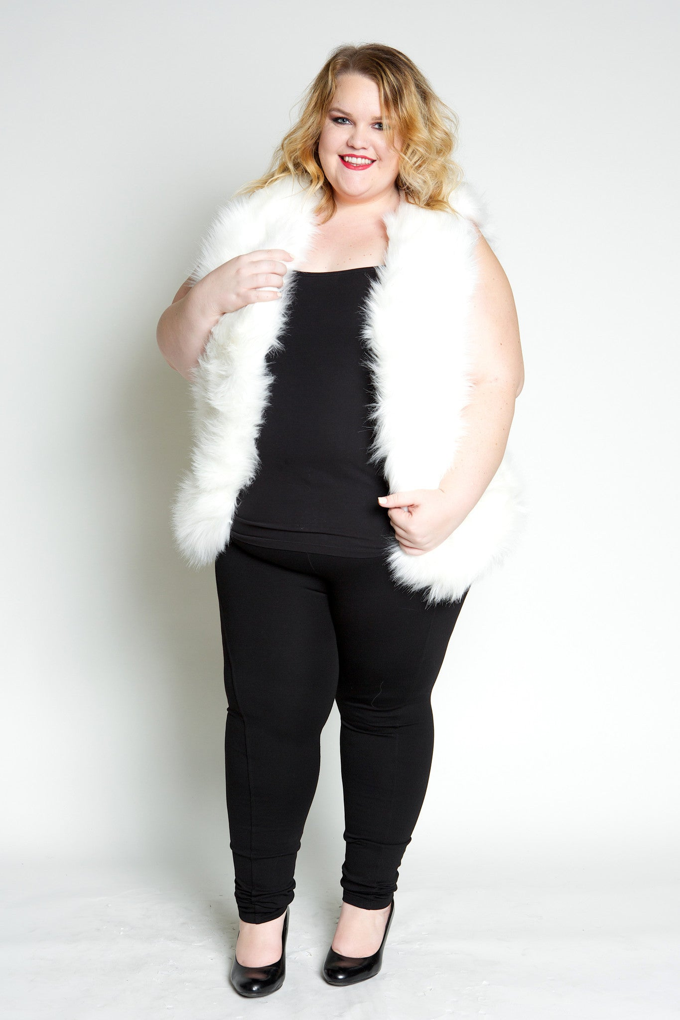 As seen on Ashley Nell Tipton, Project runway winner! Cuddle up in this super soft, luxe faux fur vest! The perfect accessory to take any outfit to the next level, you'll be the envy of all your friends! Be prepared for extra hugs ;) SELF:80%NYLON 20%POLYESTER LINING:100%POLYESTER MADE IN CHINA Font length Back length Arm hole Size:16/18 28