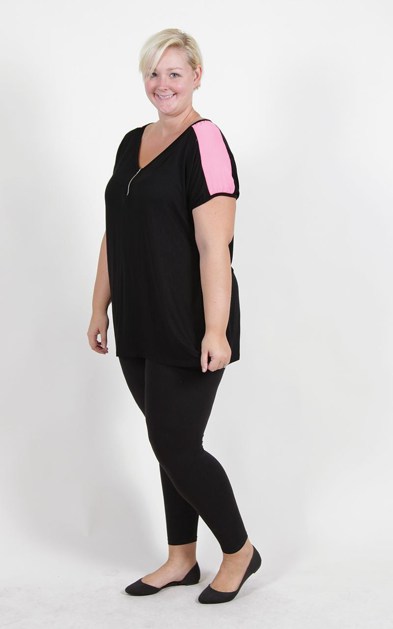 Work out gear doesn't have to be bland. In fact, we strongly believe they shouldn't. This top puts the werk in workout. The black short sleeve is simple enough, but the neon pink shoulders and zipper detailing in the front add a touch of style to your active look. 95% Rayon 5% Spandex Hand wash with col water Hang dry Made in U.S.A