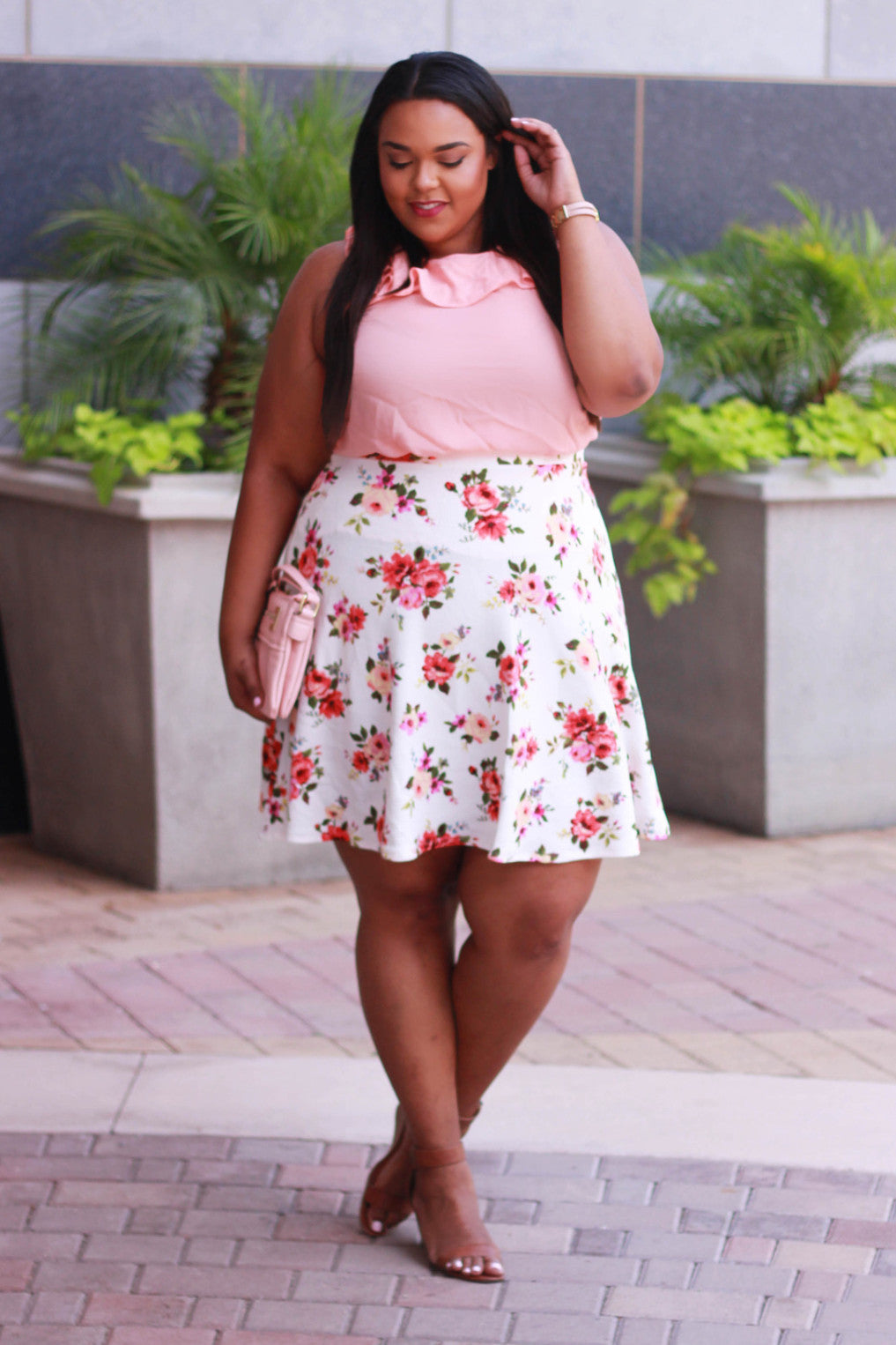Make going to work on Monday easy and breezy with this floral printed A-line skirt. Pair with your favorite tee and white sneakers for an effortless, casual, weekend look. With a 2 inch waist band and 3 inches of stretch, this skirt is not only fashionable, but is comfortable and fits just right. 95% Polyester 5% Spandex Size Waist Low Hips Length Sweep ???14/16 35