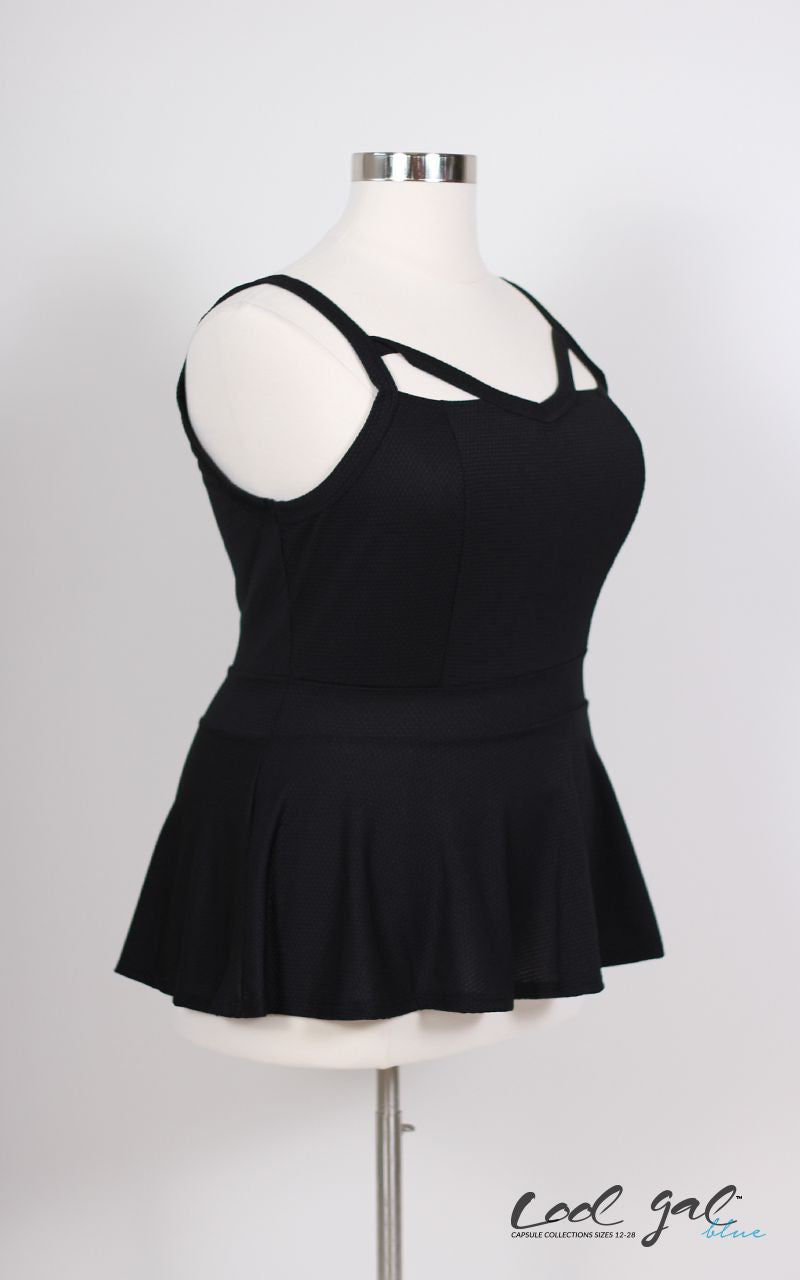 Peplum tops are a curvy girl's dream, and in a simple black color with cut outs to pair with jeans or slacks for every situation. 95% Polyester, 5% Spandex