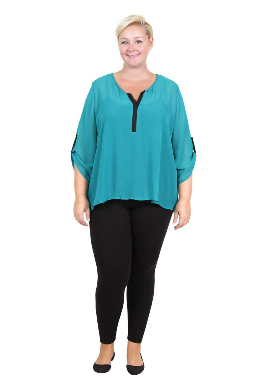 100% Polyester, semi sheer fabric. The envelope back of this top accommodates a wider waist and hips. Hooray!